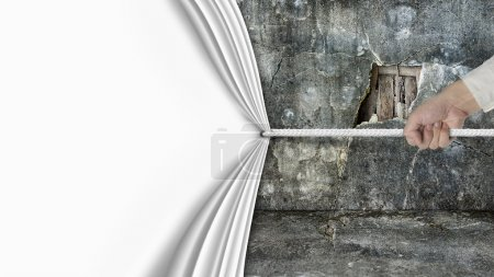 hand pulling open blank curtain covered old broken wall ruins