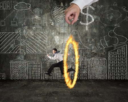 Man jumping through fire circle hand holding with doodles wall