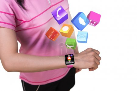Photo pour Femme de sport utilisant la montre intelligente d'écran tactile avec des icônes colorées d'application d'isolement sur le fond blanc - image libre de droit