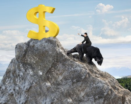 Photo for Businessman riding black bear pursuing gold dollar sign on mountain peak with sky clouds background. Fight back bearish market concept. - Royalty Free Image