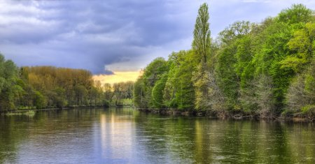 Photo for Cloudy sunset over the river Cher, an important river in the Central region of France, a tributary of the left Loire. - Royalty Free Image