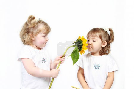 Little sisters with sunflowers