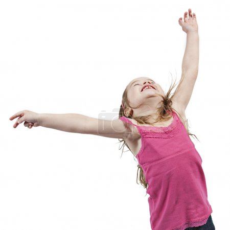little girl jumping in air.
