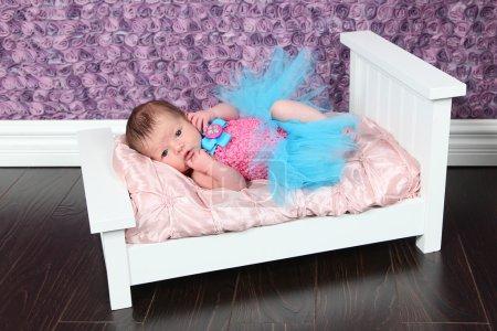Newborn Baby Girl on bed