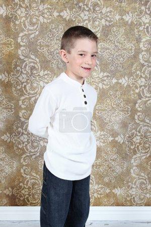 Little boy posing in studio