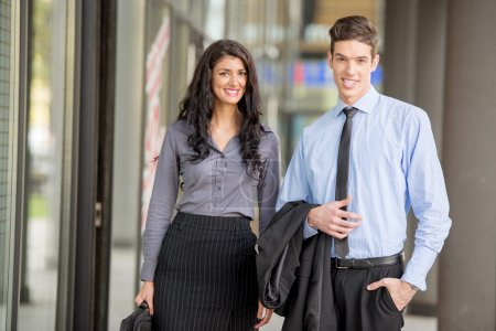 Photo for Close-up of a young businessmen and businesswomen walking outside. - Royalty Free Image