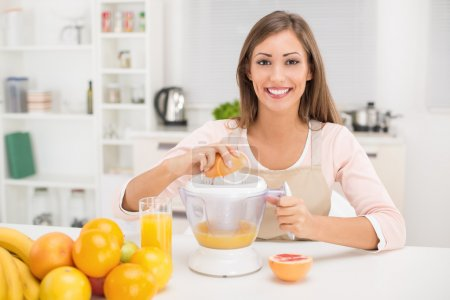 Girl preparing Healthy juice