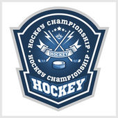 Hockey championship logo labels on shield with two crossed hockey sticks Vector sport logo design