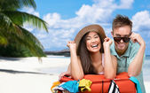 Happy couple packs up suitcase with clothing for traveling