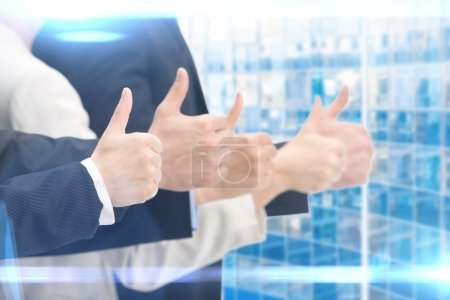 Photo for Close up of people thumbing up hands, blue background. Concept of teamwork and cooperation - Royalty Free Image