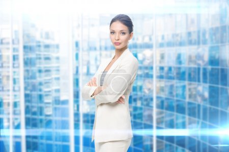 Portrait of business woman with hands crossed