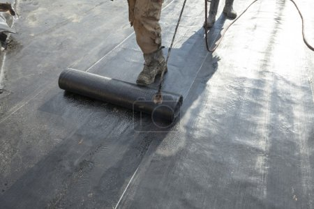 waterproofing roll bituminous material in the trench. constructi