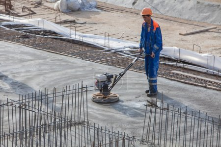 Worker produces the grout