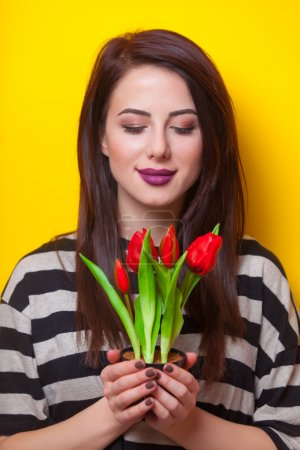 portrait of a young woman with tulips
