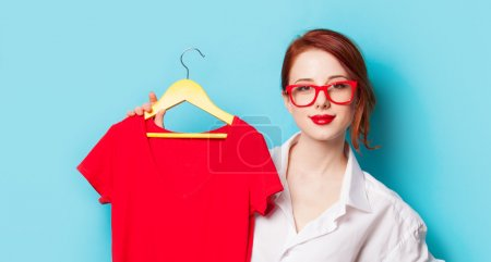 Redhead designer with red dress