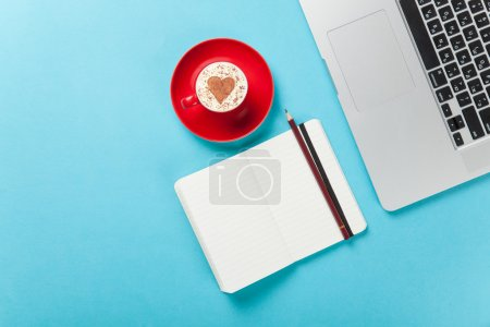 cappuccino and note near laptop