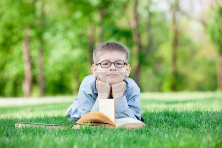 young boy with a book