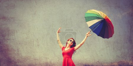 Woman in red dress with umbrella