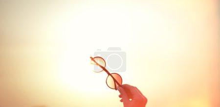 Female holding sunglasses