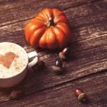 Постер, плакат: Cup and pine cone with acorn and pumpkin