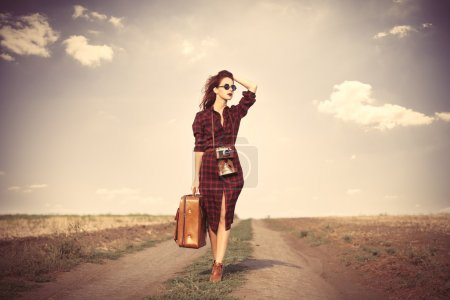 Girl with bag and camera