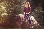 Redhead girl with horse