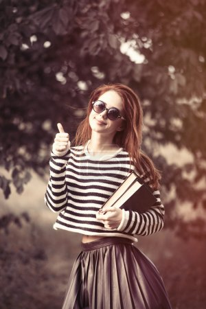 girl in striped sweater with books