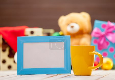 Cup of coffee or tea with blue photo frame