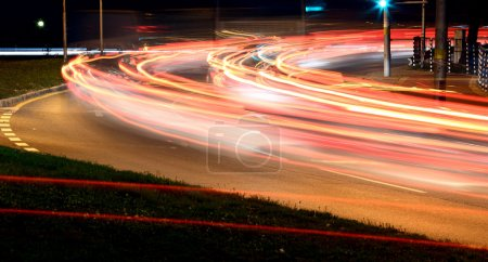 Photo for Traffic at night with traces of car lights - Royalty Free Image