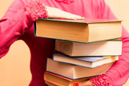 A large number of books in the hands