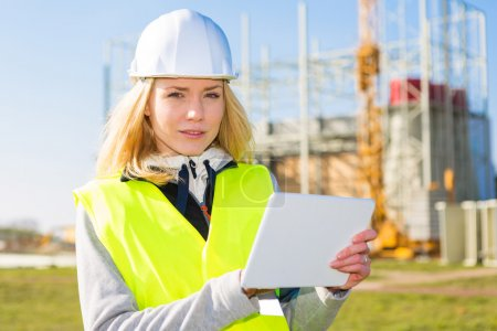 Portrait of an attractive woman worker on a construction site