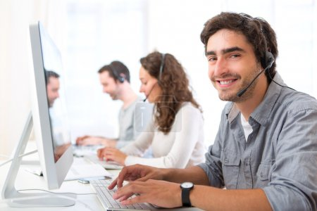 Photo for View of a Young attractive man working in a call center - Royalty Free Image