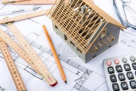 House miniature under construction on an architect desk