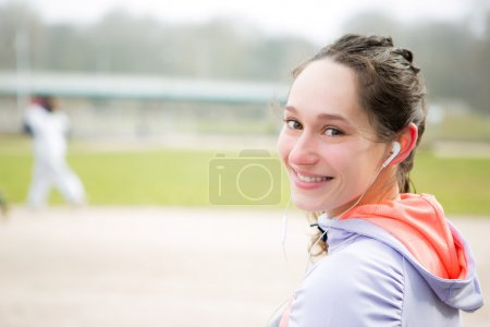 Portrait of a young attractive woman after a running session