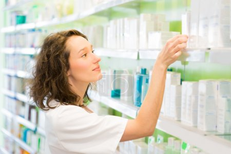 Photo for VIew of an Attractive pharmacist clean the store up - Royalty Free Image