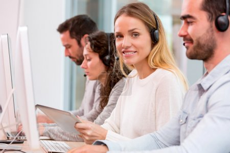 Photo for View of a Young attractive woman working in a call center - Royalty Free Image