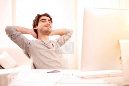 Young man relaxing during a break at the office
