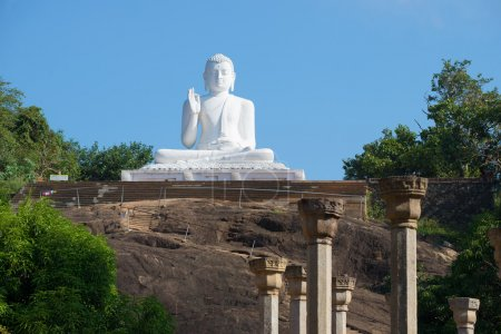 Sculpture of a seated Buddha in front. Mihintale, Sri Lanka