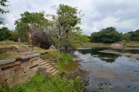 The ruins of the ancient Buddhist monastery Rajagiri Kanda near a Pond of Black Water. Mihintale, Sri Lanka