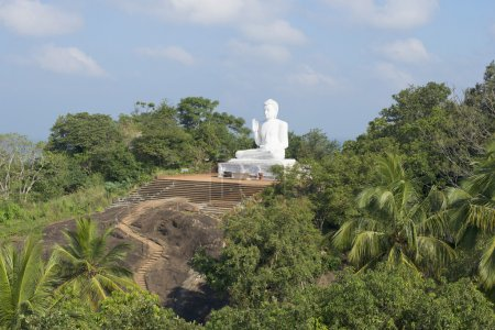Sculpture of a seated Buddha on a mountain top. Mihintale, Sri Lanka