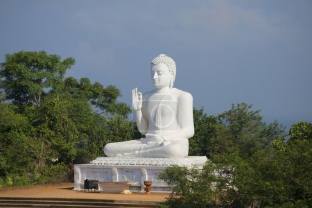 Sculpture of a seated Buddha in the monastery. Mihintale, Sri Lanka