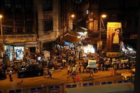 Dark city traffic blurred in motion at late evening on crowded streets in Calcutta