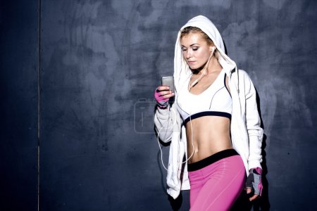 Photo for Attractive fitness woman with mp3 player, caucasian model - Royalty Free Image