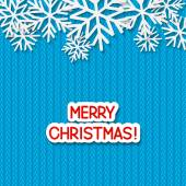 Blue Christmas background with paper snowflakes