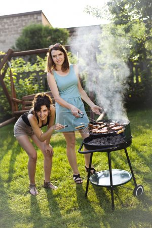 Girls making food on grill
