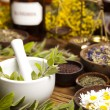 Natural medicine, herbs, mortar on wooden table...