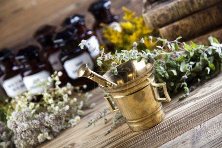 Medical bottles, herbs with mortar