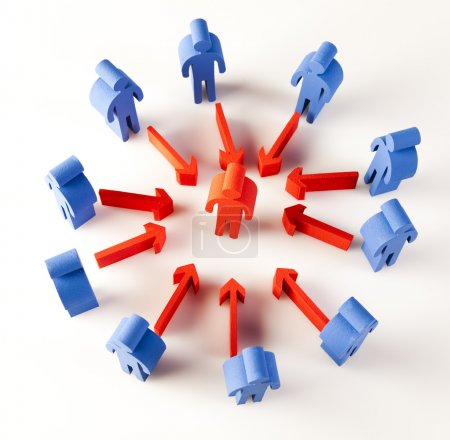 Photo for Conceptual image of teamwork. blue figures around red figure in the middle - Royalty Free Image