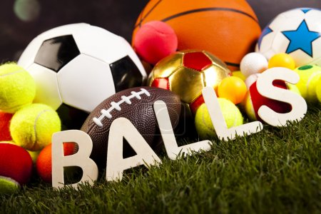 Photo for Heap of sports balls with balls word on green grass - Royalty Free Image