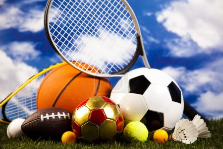 Photo for Heap of sports balls with equipment on cloudy sky background - Royalty Free Image